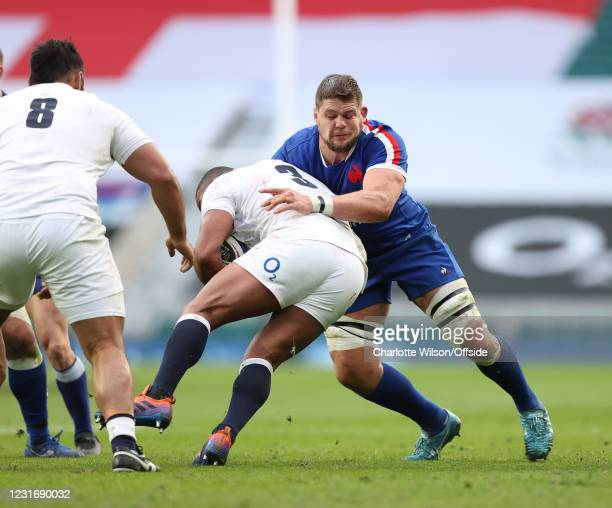 Paul Willemse of France tackles English prop Kyle Sinkler during the Guinness Six Nations match between England and France at Twickenham Stadium on...