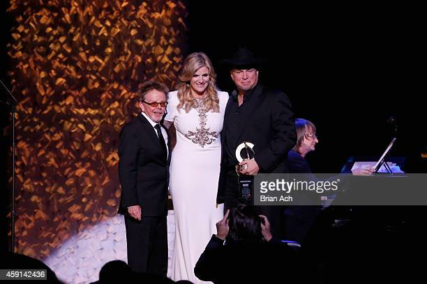 Paul Williams and Trisha Yearwood present Garth Brooks with an award onstage at the ASCAP Centennial Awards at Waldorf Astoria Hotel on November 17...