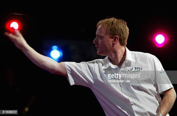 Paul Williams of England in action as he loses to Steve Beaton of England during the 2004 Skybet World Darts Grand Prix First Round match between...