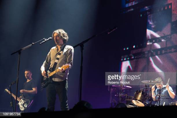 Paul Wilson Gary Lightbody and Jonny Quinn of Snow Patrol perform on stage at The SSE Hydro on January 31 2019 in Glasgow Scotland
