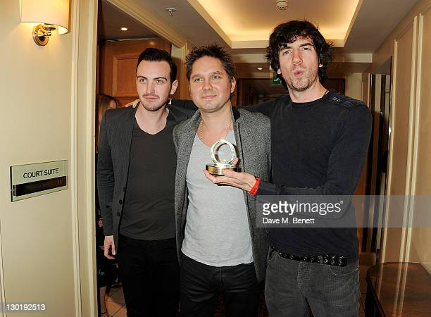 Paul Wilson Jonny Quinn and Gary Lightbody of Q Classic Song Winner Snow Patrol pose in the press room at the Q Awards 2011 held at The Grosvenor...