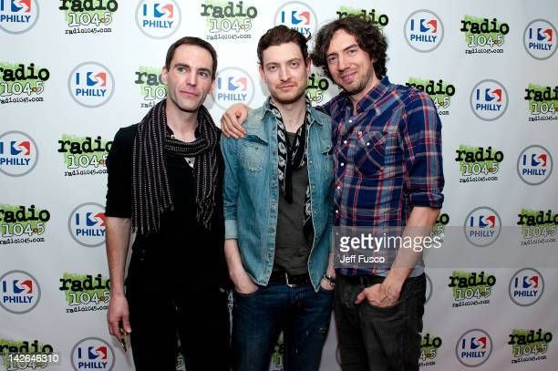 Paul Wilson Nathan Connolly and Gary Lightbody of Snow Patrol pose at the Radio 1045 iHeart Performance Theater on April 10 2012 in Bala Cynwyd...