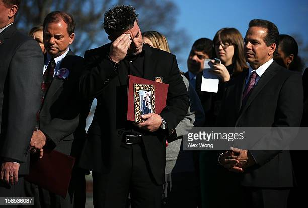 Paul Wilson of Seal Beach California who lost his wife Christy in a shooting at a hair salon listens during a news conference at the House Triangle...