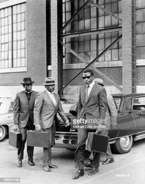 Paul Winfield Bernie Hamilton and Sidney Poitier exit a car in a scene from the film 'The Lost Man' 1969