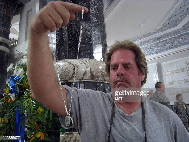 Paul Woods a Vietnam veteran and private contractor who's drive convoys in Iraq for three years shows a necklace he wears as a goodluck charm to keep...