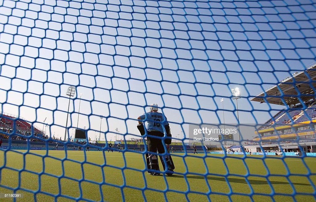 Paul Woolford of New Zealand looks on against Australia in the men's field hockey preliminaries match on August 15, 2004 during the Athens 2004 Summer Olympic Games at the Helliniko Olympic Complex Hockey Centre in Athens, Greece. Australia defeated New Zealand 4-1.