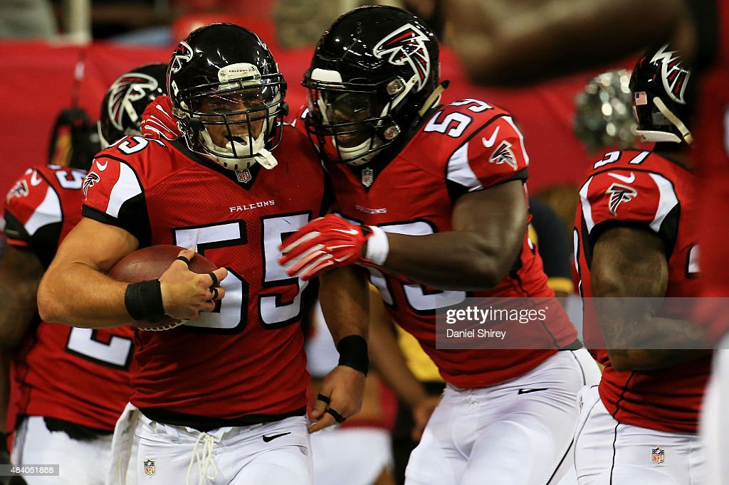 Paul Worrilow #55 celebrates scoring a touchdown after returning a fumble with Joplo Bartu #59 of the Atlanta Falcons in the first half against the Tennessee Titans at the Georgia Dome on August 14, 2015 in Atlanta, Georgia.