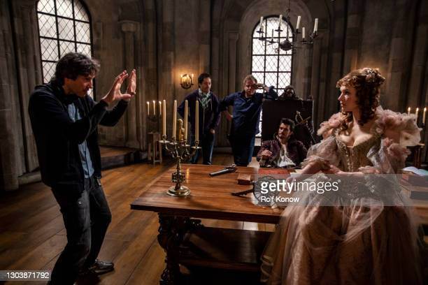 """Paul W.S Anderson directing Milla Jovovich on the set of """"The Three Musketeers"""" directed by Paul W.S. Anderson"""