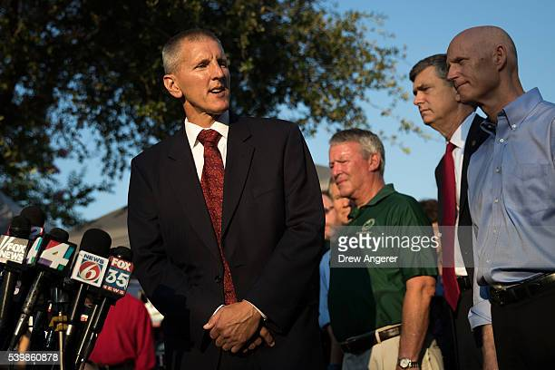 Paul Wysopal Federal Bureau of Investigation special agent in charge of the Tampa Division speaks as Florida Governor Rick Scott looks on during a...