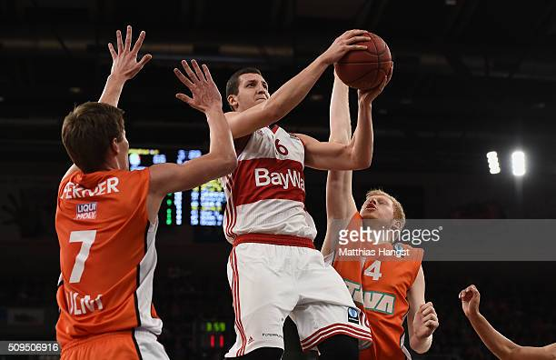 Paul Zipser of FC Bayern Muenchen is challenged by Joschka Ferner of Ulm and Philipp Neumann of Ulm during the Eurocup Basketball match between...