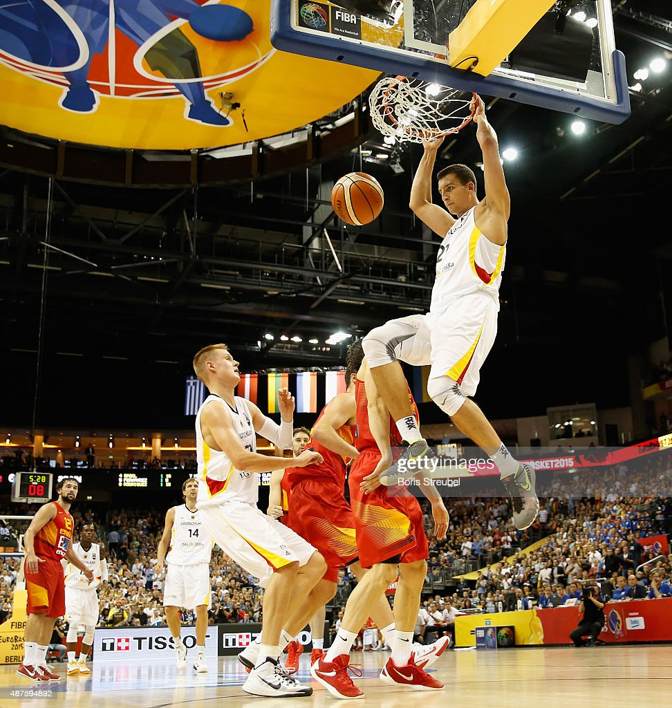 Paul Zipser (R) of Germany dunks the ball during the FIBA EuroBasket 2015 Group B basketball match between Germany and Spain at Arena of EuroBasket 2015 on September 10, 2015 in Berlin, Germany.