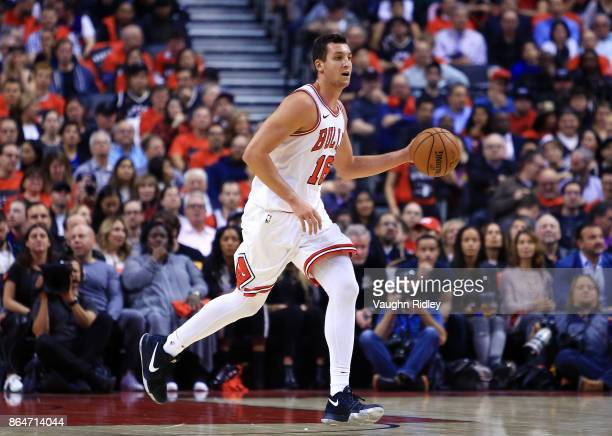 Paul Zipser of the Chicago Bulls dribbles the ball during to the first half of an NBA game against the Toronto Raptors at Air Canada Centre on...