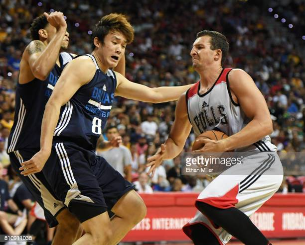 Paul Zipser of the Chicago Bulls drives against Ding Yanyuhang of the Dallas Mavericks during the 2017 Summer League at the Thomas Mack Center on...