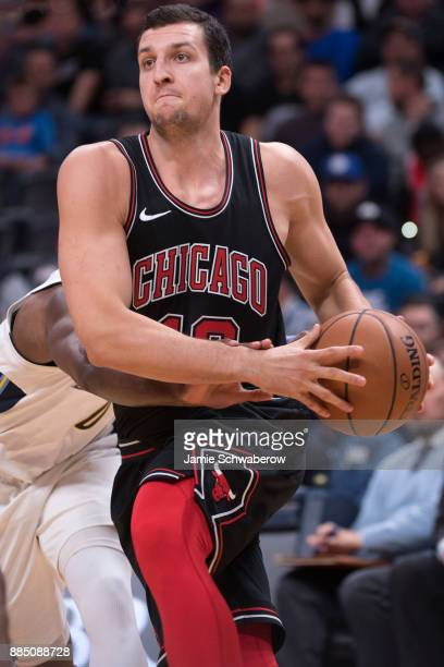 Paul Zipser of the Chicago Bulls drives to the hoop against the Denver Nuggets at Pepsi Center on November 30 2017 in Denver Colorado