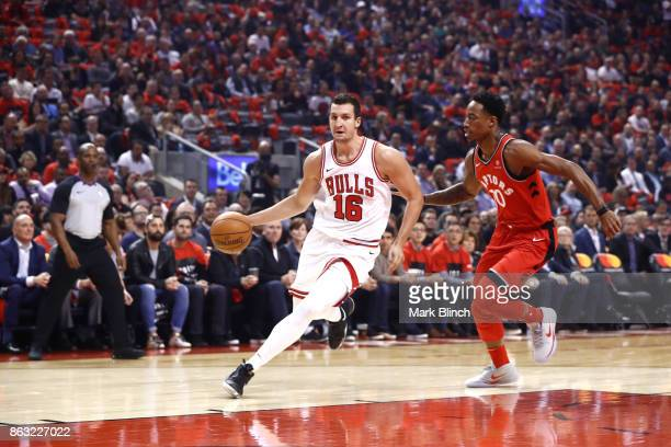 Paul Zipser of the Chicago Bulls handles the ball against DeMar DeRozan of the Toronto Raptors during the game on October 19 2017 at the Air Canada...