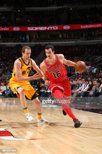 Paul Zipser of the Chicago Bulls handles the ball against Joe Ingles of the Utah Jazz on December 13 2017 at the United Center in Chicago Illinois...