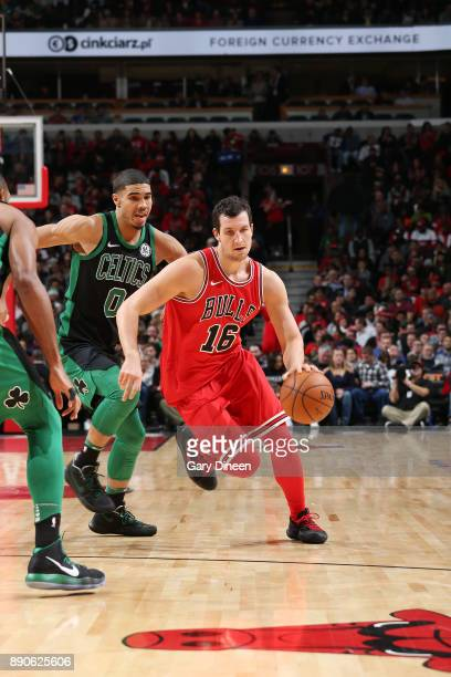 Paul Zipser of the Chicago Bulls handles the ball against the Boston Celtics on December 11 2017 at the United Center in Chicago Illinois NOTE TO...