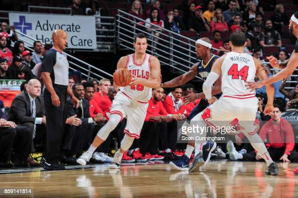 Paul Zipser of the Chicago Bulls handles the ball during the preseason game against the New Orleans Pelicans on October 8 2017 at United Center in...