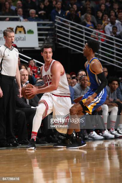 Paul Zipser of the Chicago Bulls looks to pass the ball against the Golden State Warriors on March 2 2017 at the United Center in Chicago Illinois...