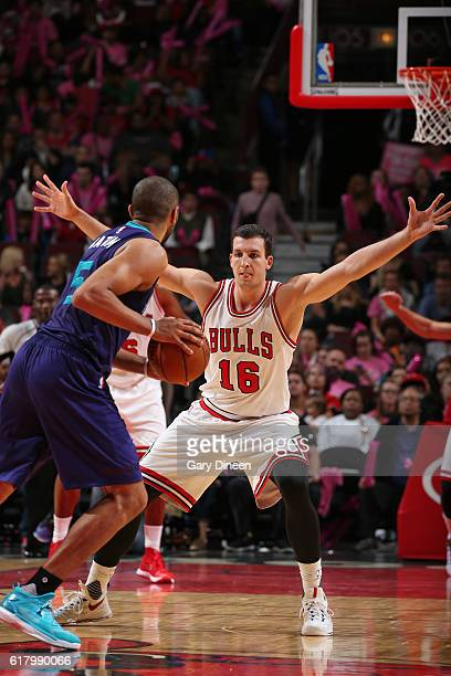 Paul Zipser of the Chicago Bulls plays defense against the Charlotte Hornets during an NBA preseason game on October 17 2016 at the United Center in...