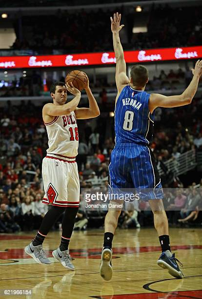 Paul Zipser of the Chicago Bulls shoots over Mario Hezonja of the Orlando Magic at the United Center on November 7 2016 in Chicago Illinois The Bulls...