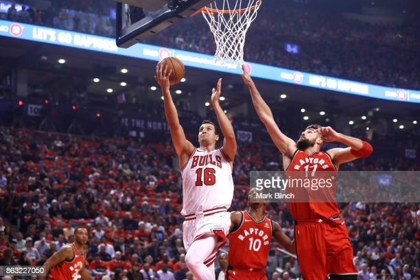 Paul Zipser of the Chicago Bulls shoots the ball against Jonas Valanciunas of the Toronto Raptors during the game on October 19 2017 at the Air...