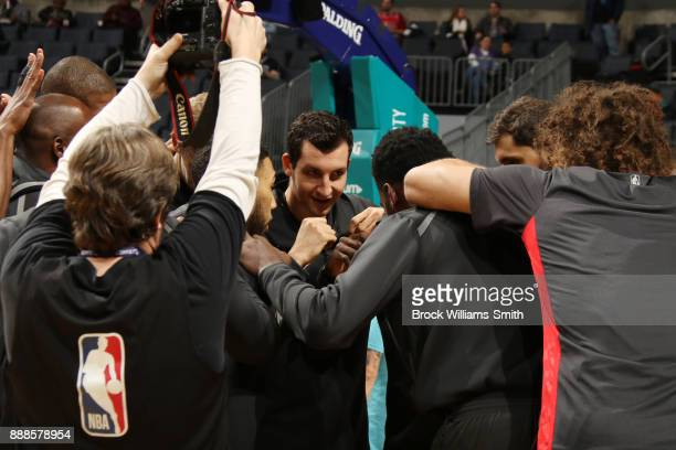 Paul Zipser of the Chicago Bulls with his teammates huddle before the game against the Charlotte Hornets on December 8 2017 at Spectrum Center in...