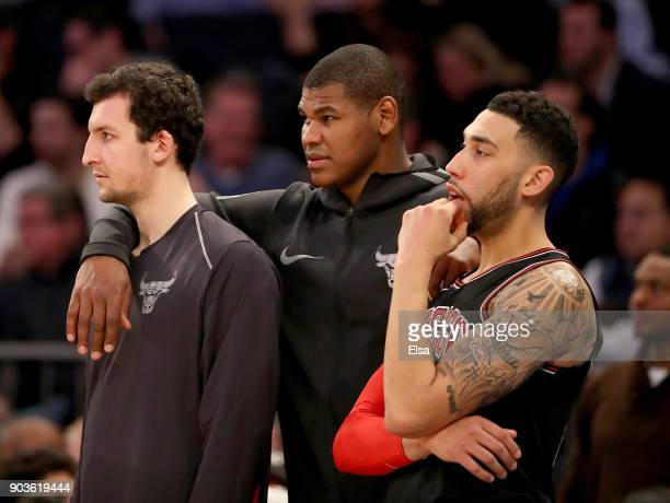 Paul ZipserCristiano Felicio and Denzel Valentine of the Chicago Bulls look on from the bench in the second overtime against the New York Knicks at...