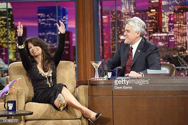 Paula Abdul and Jay Leno Walking on stage with a party hat on her head and a martini glass in her hand Paula Abdul came to 'The Tonight Show With Jay...