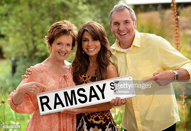 Paula Abdul poses with actors Jackie Woodburne and Alan Fletcher on the set of Australian television soap opera 'Neighbours' where she will appear in...