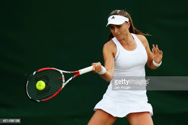 Paula Badosa Gibert of Spain during her Girls' Singles first round match against Luisa Stefani of Brazil on day seven of the Wimbledon Lawn Tennis...