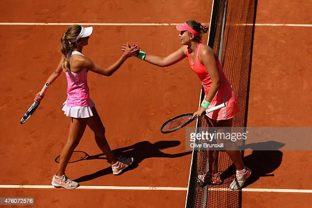 Paula Badosa Gibert of Spain is congratulated on winning by Anna Kalinskaya of Russia after the girl's singles final match on day fourteen of the...