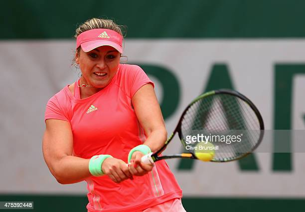 Paula Badosa Gibert of Spain plays a backhand in her girl's singles match against Deria Nur Haliza of Indonesia on day eight of the 2015 French Open...