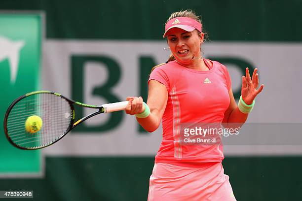 Paula Badosa Gibert of Spain plays a forehand in her girl's singles match against Deria Nur Haliza of Indonesia on day eight of the 2015 French Open...