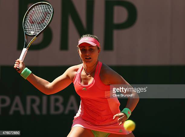Paula Badosa Gibert of Spain plays a forehand in the girl's singles final match against Anna Kalinskaya of Russia on day fourteen of the 2015 French...