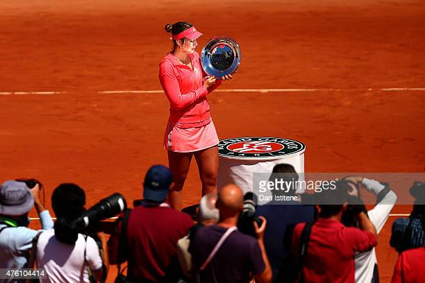 Paula Badosa Gibert of Spain poses with the trophy after winning the girl's singles final match against Anna Kalinskaya of Russia on day fourteen of...
