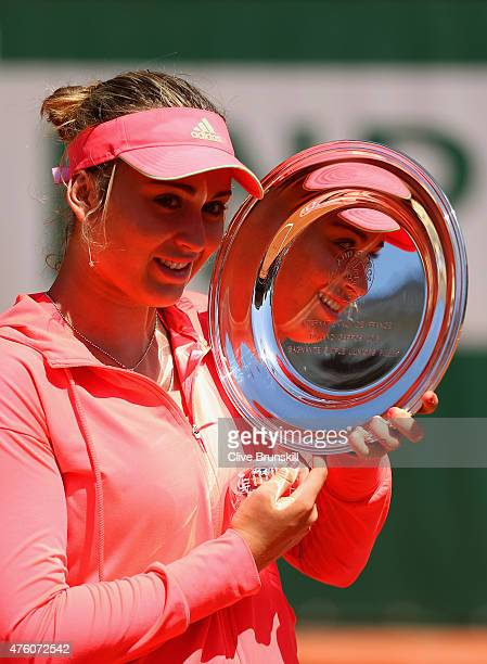 Paula Badosa Gibert of Spain poses with the winner's trophy after the girl's singles final match against Anna Kalinskaya of Russia on day fourteen of...
