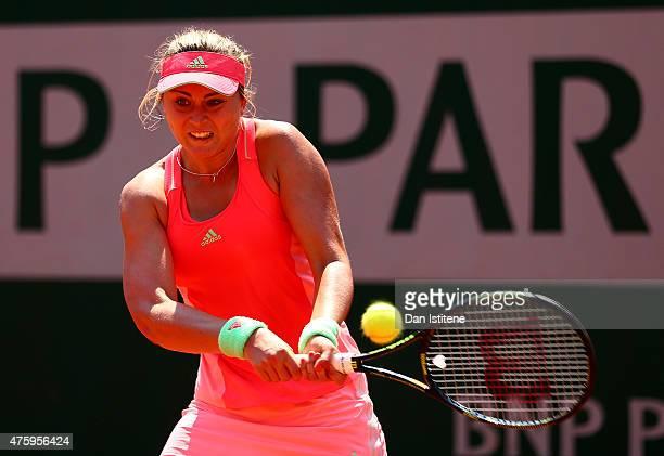 Paula Badosa Gibert of Spain returns a shot during her girls' singles semi final match against Marketa Vondrousova of Czech Republic on day thirteen...