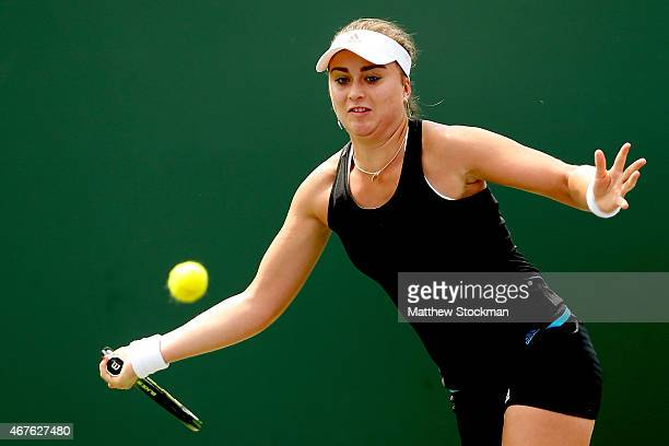 Paula Badosa Gibert of Spain returns a shot to Saisai Zheng of China during day 4 of the Miami Open Presented by Itau at Crandon Park Tennis Center...