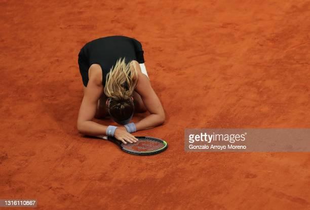 Paula Badosa of Spain celebrates after winning match point during her match against Anastasija Sevastova of Latvia at La Caja Magica on May 03, 2021...