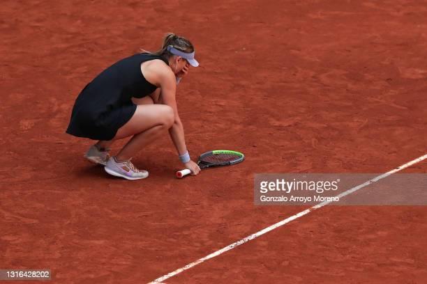 Paula Badosa of Spain celebrates winning her quarterfinal match against Belinda Bencic of Switzerland during day seven of the Mutua Madrid Open at La...