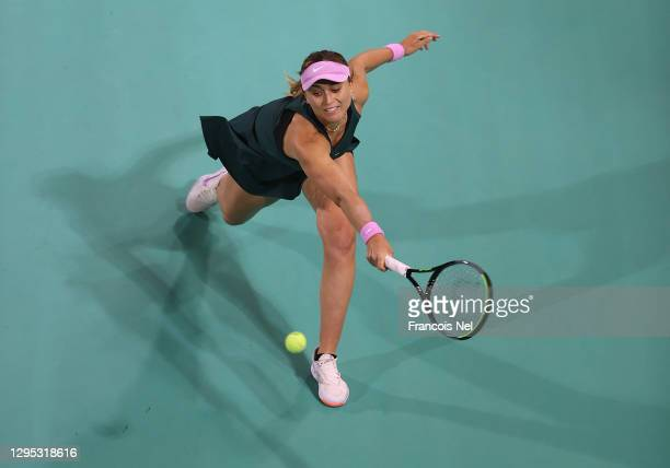 Paula Badosa of Spain plays a backhand against Alize Cornet of France during her Women's Singles match on Day Three of the Abu Dhabi WTA Women's...