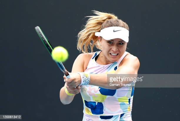 Paula Badosa of Spain plays a backhand during her Women's Singles first round match against Johanna Larsson of Sweden on day one of the 2020...