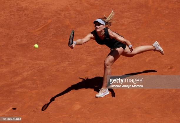 Paula Badosa of Spain plays a backhandhand during her third round match against Ashleigh Barty of Australia during day eight of the Mutua Madrid Open...