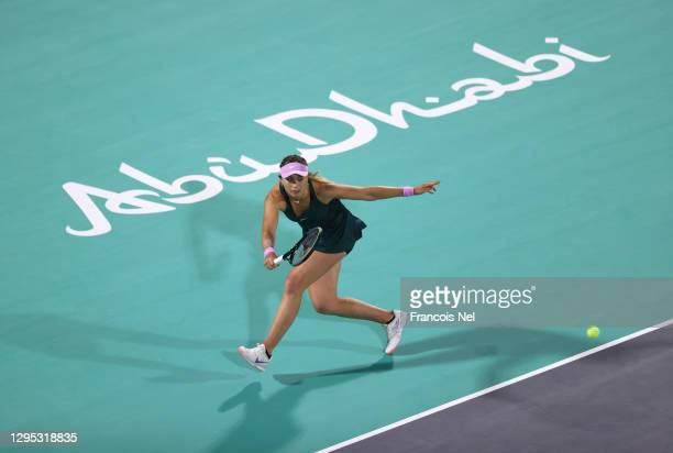 Paula Badosa of Spain plays a forehand against Alize Cornet of France during her Women's Singles match on Day Three of the Abu Dhabi WTA Women's...