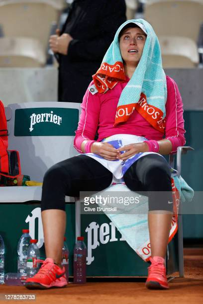 Paula Badosa of Spain reacts as she sits down following victory in her Women's Singles third round match against Jelena Ostapenko of Latvia on day...