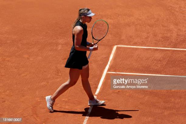 Paula Badosa of Spain reacts during her third round match against Ashleigh Barty of Australia during day eight of the Mutua Madrid Open at La Caja...