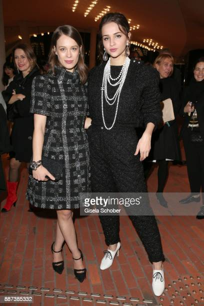 Paula Beer and Lisa Vicari during the Chanel Trombinoscope Collection des Metiers d'Art 2017/18 photo call at Elbphilharmonie on December 6 2017 in...