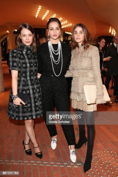 Paula Beer Lisa Vicari and Lisa Tomaschewsky during the Chanel Trombinoscope Collection des Metiers d'Art 2017/18 photo call at Elbphilharmonie on...