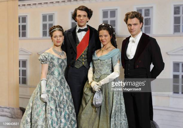 Paula Beer Sabin Tambrea Hannah Herzsprung and Friedrich Muecke pose during the Ludwig II Set Visit at the Bavaria Film Studios on October 19 2011 in...